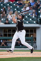 Dan Black (27) of the Charlotte Knights follows through on his swing against the Louisville Bats at BB&T BallPark on May 12, 2015 in Charlotte, North Carolina.  The Knights defeated the Bats 4-0.  (Brian Westerholt/Four Seam Images)