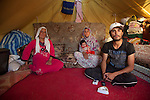 DOMIZ, IRAQ: Fadhi, a Syrian refugee, and his two wives and child in the Domiz refugee camp..Over 7,000 Syrian Kurds have fled the violence in Syria and are living in the Domiz refugee camp in the semi-autonomous region of Iraqi Kurdistan...Photo by Ali Arkady/Metrography