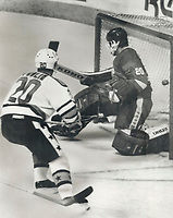1987 FILE PHOTO - ARCHIVES -<br /> <br /> The winner: Dave Poulin of the Philadelphia Flyers became an instant hero last night in Quebec city when he scored this goal against the Soviet national team at 18:45 of the third period to give the National Hockey League All-Stars a 4-3 victory over the visitors at Rendez-Vous 87. The Soviet goaltender is Evgeny Belosheikin. Netminder Grant Fuhr of the Edmonton Oilers; however; was the individual star; making many excellent saves. Second game is tomorrow night.<br /> <br /> PHOTO :  Mike Slaughter  - Toronto Star Archives - AQP
