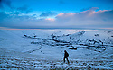 04/02/15<br /> <br /> After a night with temperatures falling well below freezing, a hiker makes his way up Mam Tor in the Derbyshire Peak District near Castleton at dawn this morning.<br /> All Rights Reserved - F Stop Press.  www.fstoppress.com. Tel: +44 (0)1335 418629 +44(0)7765 242650
