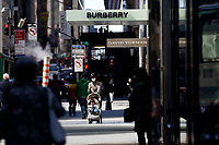 NEW YORK, NEW YORK - MARCH 12: People walk around Burberry store on March 12, 2021 in New York. Burberry expects full-year profits to beat market forecasts after a rebound in sales in the fourth quarter, sending its shares more than 6% higher. (Photo by Emaz/VIEWpress)