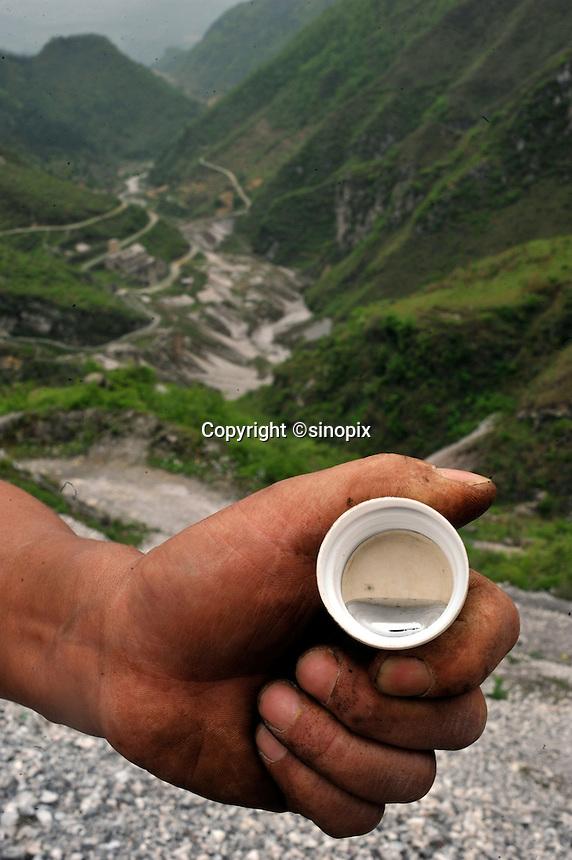 Mr Cao holds a piece of mercury at the  Yin Ye Mining Co Ltd, in Luoxi Mercury Mining Area, near Wanchuan, Guizhou, China, 20th April 2009.<br /> <br /> Photo by Richard Jones