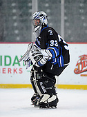 Brockport Blue Devils Riley Emmerson (33) during warmups before a varsity ice hockey game against the Notre Dame Fighting Irish of Batavia during the Section V Rivalry portion of the Frozen Frontier outdoor hockey event at Frontier Field on December 22, 2013 in Rochester, New York.  (Copyright Mike Janes Photography)