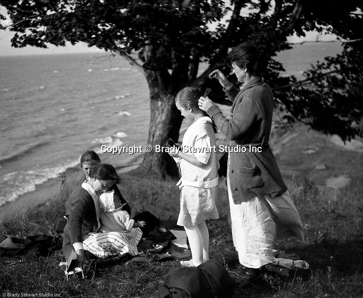 Erie PA:  Sarah Stewart and her sisters and niece relaxing on a bluff overlooking Lake Erie.