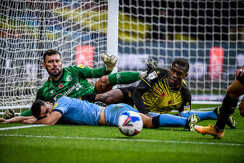 7th November 2020; Vicarage Road, Watford, Hertfordshire, England; English Football League Championship Football, Watford versus Coventry City; A scramble in the box with Ben Foster (GK) Christian Kabasele and Maxime Biamou all vying for the ball