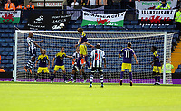 Pictured: Nicolas Anelka of West Brom (L) fails to score with a header after the ball was deflected by Michu of Swansea who jumps in the air (C). Sunday 01 September 2013<br /> Re: Barclay's Premier League, West Bromwich Albion v Swansea City FC at The Hawthorns, Birmingham, UK.