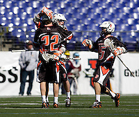 Tyler Moni (27) is congratulated on his goal by Princeton teammates Rob Engelke (22) and Chris McBride (15) during the Face-Off Classic in at M&T Stadium in Baltimore, MD