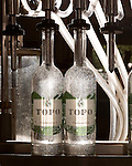 June 18, 2013. Chapel Hill, North Carolina<br />  Bottles of TOPO Gin are filled using a repurposed milking machine.<br />  TOPO, Top of the Hill Distillery, the brainchild of owner Scott Maitland and Spirit Guide Esteban McMahan, is located in the old N&O Building on Franklin Street. Making gin, vodka and American whiskey from locally sourced wheat, they are one of the few distilleries bringing  organic liquor to ABC shelves around the state.