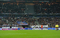 Team France and team USA stand for a moment of silence prior to the friendly match France against USA at the Stade de France in Paris, France on November 11th, 2011.