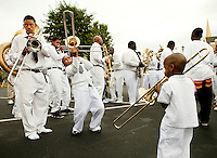 Brass bands and thundering preachers welcomed believers attending the annual mass baptism at the United House of Prayer for All People in Charlotte, NC. The Charlotte Pentecostal church was one of many United House of Prayer churches holding the group baptism in October 2009. The tradition of baptism by fire hose started nearly a century ago as a way for members to periodically wash away their sins and heal physical ailments. The Charlotte, North Carolina United House of Prayer is located at 537 Beatties Ford Road, Charlotte, NC.