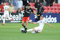 WASHINGTON, DC - MARCH 07: Edison Flores #10 of D.C. United battles the ball with Matias Pellegrini #11 of Inter Miami CF during a game between Inter Miami CF and D.C. United at Audi Field on March 07, 2020 in Washington, DC.