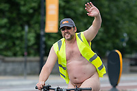 A participant of the World Naked Bike Ride in Cardiff city centre wearing a British Naturism cap on 25 July 2021. The protest aims to highlight the vulnerability of cyclists against traffic in cities, with the human body presented as a contrast to high powered vehicles. Photo by Mark Hawkins.