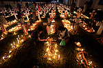 Pictured: Thousands of people lay canal lights as they remember and pray for their departed relatives on All Souls Day at the Holy Rosary Church Tejgaon in the capital Dhaka, Bangladesh last night (Monday).<br /> <br /> All Souls' Day is a day of prayer and remembrance for the souls of those who have died, which is observed by Catholics and other Christian denominations annually on the 2nd November. <br /> <br /> These poignant photographs were taken by photographer Azim Khan Ronnie.<br /> <br /> Requiem masses are commonly held, and many people visit and sometimes decorate the graves of loved ones.<br /> <br /> Please byline: Azim Khan Ronnie/Solent News<br /> <br /> © Azim Khan Ronnie/Solent News & Photo Agency<br /> UK +44 (0) 2380 458800