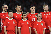 (L-R) Gareth Bale, Aaron Ramsey, Tom Lawrence and Ben Davies of Wales sing the national anthem during the UEFA Nations League B match between Wales and Ireland at Cardiff City Stadium in Cardiff, Wales, UK.September 6, 2018