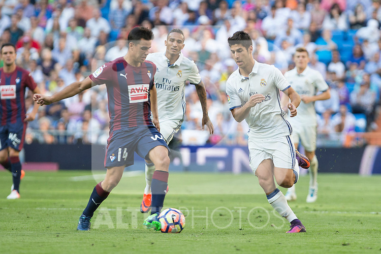 Eibar's Dani Garcia and Real Madrid's Marco Asensio during the match of La Liga between Real Madrid and SD Eibar at Santiago Bernabeu Stadium in Madrid. October 02, 2016. (ALTERPHOTOS/Rodrigo Jimenez)