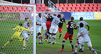 WASHINGTON, DC - NOVEMBER 8: Ola Kamara #9 of D.C. United heads the ball during a game between Montreal Impact and D.C. United at Audi Field on November 8, 2020 in Washington, DC.