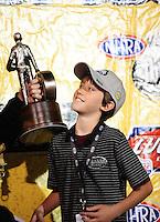 Jun. 19, 2011; Bristol, TN, USA: NHRA top fuel dragster driver Larry Dixon children celebrates after the Thunder Valley Nationals at Bristol Dragway. Mandatory Credit: Mark J. Rebilas-