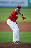 Auburn Doubledays pitcher McKenzie Mills (14) delivers a pitch during a game against the State College Spikes on July 6, 2015 at Falcon Park in Auburn, New York.  State College defeated Auburn 9-7.  (Mike Janes/Four Seam Images)