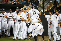 UCF Knights left fielder Bryce Peterson (13) celebrates with teammates after scoring a run during a game against the Siena Saints on February 17, 2017 at UCF Baseball Complex in Orlando, Florida.  UCF defeated Siena 17-6.  (Mike Janes/Four Seam Images)
