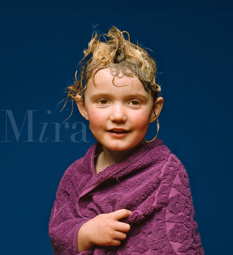 Child, 5 years old, with her hair just washed after a bath, wrapped in a towel..