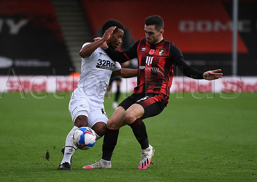 31st October 2020; Vitality Stadium, Bournemouth, Dorset, England; English Football League Championship Football, Bournemouth Athletic versus Derby County; Nathan Byrne of Derby County competes for the ball with Lewis Cook of Bournemouth