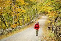 Woman walking carriage road, Acadia National Park, Hancock County, Maine, USA