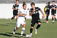 RICHMOND, VA - SEPTEMBER 30: Ben Speas #17 of North Carolina FC is chased by Jake LaCava #64 of New York Red Bulls II during a game between North Carolina FC and New York Red Bulls II at City Stadium on September 30, 2020 in Richmond, Virginia.