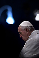 Pope Francis holds the wooden cross during the Via Crucis (Way of the Cross) torchlight procession on Good Friday in front of the Colosseum in Rome.April 15, 2017