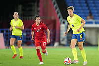 YOKOHAMA, JAPAN - AUGUST 6: Lina Hurtig #8 of Sweden and Jessie Fleming #17 of Canada battle for the ball during a game between Canada and Sweden at International Stadium Yokohama on August 6, 2021 in Yokohama, Japan.