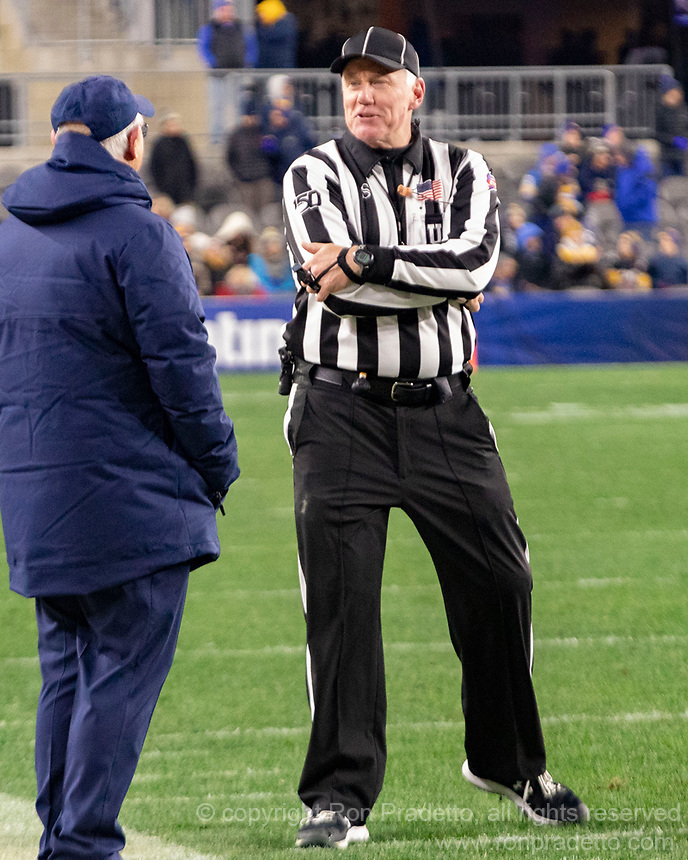 ACC football umpire James Hyson talks with North Carolina head coach Mack Brown. The Pitt Panthers defeated the North Carolina Tarheels 34-27 in overtime in the football game on November 14, 2019 at Heinz Field, Pittsburgh, Pennsylvania.