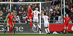 Steph houghton has her shot headed clear by Janine Beckie of Canada