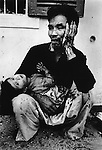 Vietnamese father and daughter wounded when U.S. Marines dropped hand grenades into their bunker, Têt offensive, Battle of Hué, Vietnam, February 1968