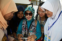 Yogyakarta, Java, Indonesia.  Indonesian Teacher and her Students from Bandung Visiting the Sultan's Palace.