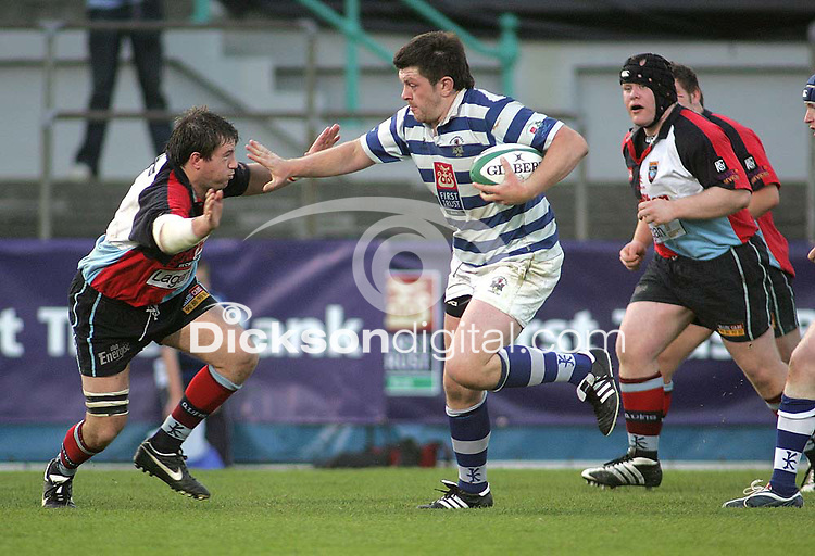 Dungannon number 8 Stuart Lamb fends off Harlequins flanker Andrew Gillespiie during the First Trust Senior Cup Final at Ravenhill. Result - Dungannon 27pts Harlequins 10pts.