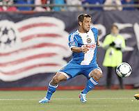 Philadelphia Union midfielder Danny Cruz (44) controls the ball.In a Major League Soccer (MLS) match, the New England Revolution (blue/red) defeated Philadelphia Union (blue/white), 2-0, at Gillette Stadium on April 27, 2013.