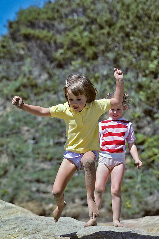 Girls jumping off rock at Seal Rock, Oregon