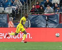 FOXBOROUGH, MA - AUGUST 4: Brian Anunga #27 of Nashville SC brings the ball forward during a game between Nashville SC and New England Revolution at Gillette Stadium on August 4, 2021 in Foxborough, Massachusetts.