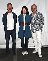 """PASADENA, CA - SEPT 9: (L-R) Aids activist Peter Staley and Directors Janet Tobias and John Hoffman attend a drive-in screening of National Geographic Documentary Films """"Fauci"""" at the Rose Bowl on September 9, 2021 in Pasadena, California. (Photo by Frank Micelotta/National Geographic/PictureGroup)"""