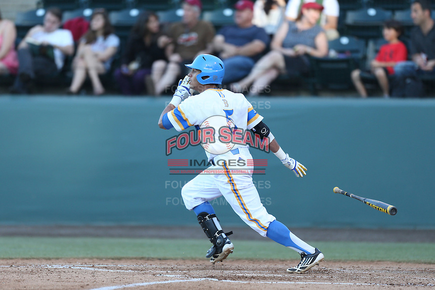Kevin Williams #5 of the UCLA Bruins bats against the Stanford Cardinal at Jackie Robinson Stadium on May 2, 2014 in Los Angeles, California. UCLA defeated Stanford, 7-2. (Larry Goren/Four Seam Images)