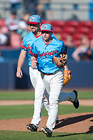 Spokane Indians shortstop Jax Biggers (1) jogs off the field in front of starting pitcher Chi Chi Gonzalez (22) between innings of a Northwest League game against the Vancouver Canadians at Avista Stadium on September 2, 2018 in Spokane, Washington. The Spokane Indians defeated the Vancouver Canadians by a score of 3-1. (Zachary Lucy/Four Seam Images)