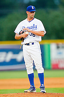 Burlington Royals relief pitcher Lincoln Rassi (36) rubs up the baseball during the game against the Danville Braves at Burlington Athletic Park on July 18, 2012 in Burlington, North Carolina.  The Royals defeated the Braves 4-3 in 11 innings.  (Brian Westerholt/Four Seam Images)