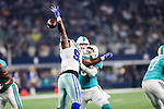 Dallas Cowboys defensive tackle Cedric Thornton (92) and Miami Dolphins center Mike Pouncey (51) in action during the pre-season game between the Miami Dolphins and the Dallas Cowboys at the AT & T stadium in Arlington, Texas.