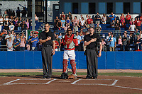 Batavia Muckdogs catcher Pablo Garcia (4) stands for the national anthem beside umpire Jae-Young Kim and home plate umpire Tyler Witte before a game against the West Virginia Black Bears on July 3, 2018 at Dwyer Stadium in Batavia, New York.  Batavia defeated West Virginia 5-4.  (Mike Janes/Four Seam Images)