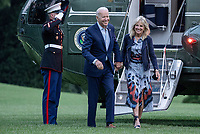 United States President Joe Biden and first lady Jill Biden walk off of Marine One on the South Lawn of the White House in Washington, DC on Sunday, July 18, 2021. The Bidens spent the weekend at Camp David, the presidential retreat near Thurmont, Maryland.  <br /> CAP/MPI/RS<br /> ©RS/MPI/Capital Pictures