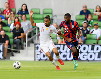 AUSTIN, TX - JULY 29: Shaq Moore #20 of the United States and Akram Afif #11 of Qatar chase after a loose ball during a game between Qatar and USMNT at Q2 Stadium on July 29, 2021 in Austin, Texas.