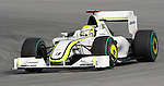 05 Apr 2009, Kuala Lumpur, Malaysia --- Brawn GP Formula 1 Team driver Jenson Button of Great Britain steers his car during the 2009 Fia Formula One Malasyan Grand Prix at the Sepang circuit near Kuala Lumpur. Photo by Victor Fraile --- Image by © Victor Fraile / The Power of Sport Images