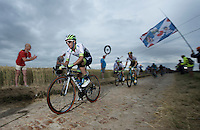 Simon Yates (GBR/Orica-GreenEDGE) on the cobbled sector of Artres (1200m)<br /> <br /> stage 4: Seraing (BEL) - Cambrai (FR) <br /> 2015 Tour de France