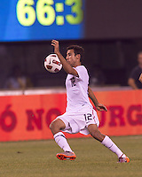 USA defender Jonathan Bornstein (12) traps the ball. Brazil  defeated the US men's national team, 2-0, in a friendly at Meadowlands Stadium on August 10, 2010.