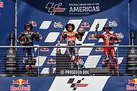 3rd October 2021; Austin, Texas, USA; Winners on the podium- Fabio Quartararo (20) - (FRA), Marc Marquez (93) - (SPA) and Francesco Bagnaia (63) - (ITA) after the MotoGP Red Bull Grand Prix of the Americas