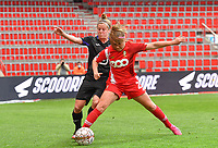 Laura Deloose (14) of Anderlecht pictured fighting for the ball with Davinia Vanmechelen (25) of Standard  during a female soccer game between Standard Femina de Liege and RSC Anderlecht on the 8th matchday in play off 1 of the 2020 - 2021 season of Belgian Scooore Womens Super League , tuesday 18 th of May 2021  in Angleur , Belgium . PHOTO SPORTPIX.BE | SPP | DAVID CATRY